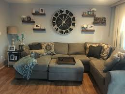 Oversized Wall Clock With Floating Shelves Living Room
