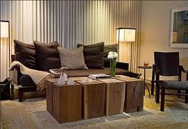RUstic Living Room With Dark Sofa Pillows Boxes Table And Double Long Lamps