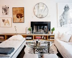 Living Room With Fireplace In The Middle by A Serene Oasis In The Middle Of New York City Home Tour Lonny
