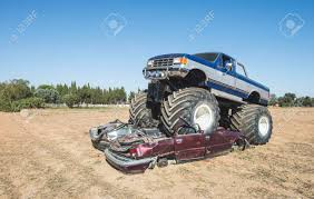 100 Blue Monster Truck Over Cars Sky Stock Photo Picture And Royalty
