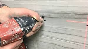 Drilling Small Holes In Porcelain Tile by How To Drill A Hole In A Tile And Add Bathroom Accessories