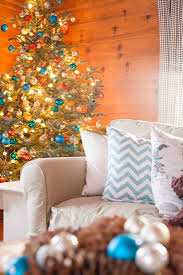 Christmas Tree Decorated Using Turquoise Rust And Blush Ornaments