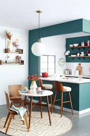 Kitchen Accent Wall A Deep Teal Tone Helps To Divide This Eating And Cooking Space An