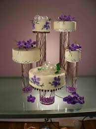 belinda purple wedding cakes with fountains classic pillared cake wired sprays of sugar roses creations gallery