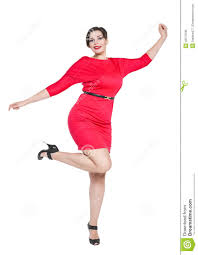 happy beautiful plus size woman in red dress with hands up stock