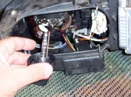 how to replace the ignitor inside the headlight not ballast a