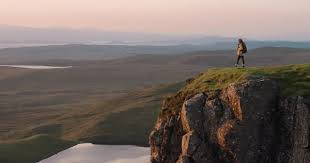 Womanler Standing At Edge Of Cliff Looking Sunrise Sky Hiker Relaxing In Scenic Landscape Enjoying