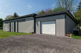 Large Grey Steel Barn In Modern Style. White Garage Door With ... Garage Doors Barn Doorrage Windows Kits New Decoration Door Design Astound Modern 20 Fisemco With Opener Youtube Large Grey Steel In Style White With Examples Ideas Pictures Megarctcom Just Best 25 Pallet Door Ideas On Pinterest Rustic Doors Diy Barn Hdware Hinged For Medallion True Swing By Artisan Worn Wood And Metal Stock Photo Image 16407542 Exterior Sliding Good The