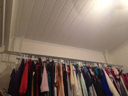 DIY hanging clothing rack $11 1 electrical conduit from Home