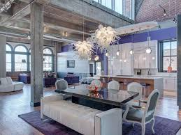 Open Loft With Purple Wall Modern Light Fixtures And Concrete Beam