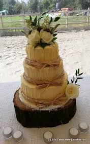 Three Tier Rustic Wedding Cake With Real Flowers And Yorkshire Roses Finished Raffia