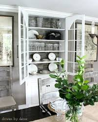 Recessed China Cabinet Built In Dining Room With Wood Backdrop And Large Pulls
