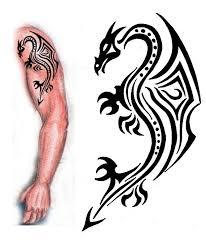 Awesome Black Tribal Dragon Tattoo On Man Left Half Sleeve