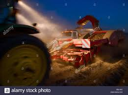 100 Truck And Tractor Pulling Games A Tractor Pulling A Two Row Potato Digger Loads Red Potatoes
