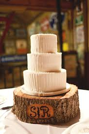 Simple White Cake On A Rustic Tree Trunk Stand