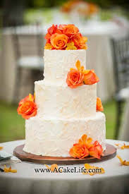 Kevin And Loretta Requested For Their Lanikuhonua Wedding A 3 Tier Ivory Buttercream Rustic Textured Cake With Fresh Orange Roses Orchids Placed On