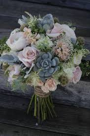A Shabby Chic Bridal Bouquet Featuring Succulents Dusty Pink Roses And Peonies