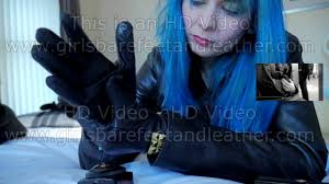 putting on leather gloves in leather jacket and leather pants
