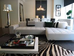 Safari Decorated Living Rooms by White Round Coffee Table Black Sectional Sofas Brown Ceramic