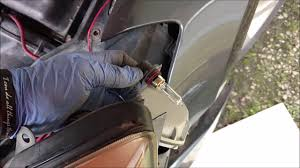 how to replace a 2008 nissan maxima headlight bulb