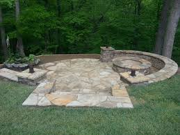 pit in a hill retaining wall water feature and lights jpg