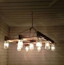Pallet chandelier bine thia with some mason jar or colored