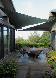 Out Of The Sun And Into The Shade: Design Innovations For Comfort ... 13 Cool Shade Sails For Your Backyard Canopykgpincom Image Of Sun Sail Residential Patio Sun Pinterest Stunning Carports Pool Triangle Best Diy Awning Youtube Structures Fabric Square Home Design Ideas Shadelogic Heavy Weight 16 Foot Lime Green Amazoncom Lawn Garden Area Rectangle X 198 For Decks Large Awnings Posts Using As Canopy Outdoor