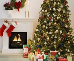 Indoor Christmas Scene Tree Presents And Fireplace With Stockings Hanging Over It
