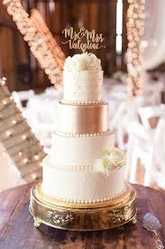 Gold And White Wedding Cake On Stand