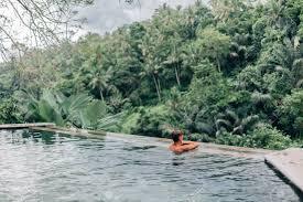 100 Bali Infinity Human Swimming In Infinity Pool With Jungle View In Ubud