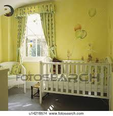 Yellow And White Curtains For Nursery by Stock Photo Of White Cot And Green Yellow Curtains In Yellow