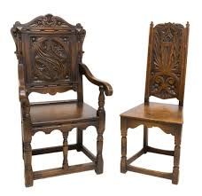 (2) ENGLISH OAK CARVED CHAIRS Rare Antique 19th Century American Gothic Handcarved Solid Oak High Back Black Leather Upholstered His Her Throne Chairs Vintage Handcarved Cane Highback Hooded Chair Set Of 8 62 Arts And Crafts Carved Oak Ding Chairs High For Kitchen Table Spanish Conquistador Contemporary Carved Wood Side 43 Sandy Brown Linen Natural Cedar Accent 31092775 About Us Italian Renaissance Style 20th Cent Mahogany Throne Chair With Lion Arms A Back Crest Stretcher Brown Country Armchair C Spning Bedroom Seating Russian Arm Newel Bishops Occasional Blue Lion