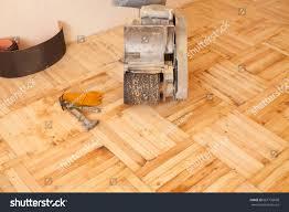 Hardwood Floor Polisher Machine by Wood Floor Polishing Maintenance Work By Stock Photo 661755868
