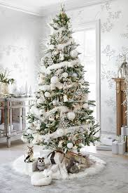 An Indoor Winter Wonderland Awaits You With Pier 1s Frosted Noel Christmas Tree Branches Sparkle A Touch Of Frost Reindeer Topper Provides