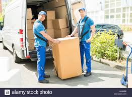 Two Happy Movers In Blue Uniform Loading Boxes In Truck Stock Photo ... Movers For Moms Movers Who Blog In Nashville Tn Houston Northwest Tx Two Men And A Truck Man With Van Fniture Removals Moving Companies Los Angeles County Local La Company Movegreen Transport Contractors And Fleet Owner Of Trucks Nawada New Delhi The Best Toronto Odessa Fl 8132516683 Type Of Vehicle Transport Services Thai To Bangkok Miracle Raleigh Nc Used 2003 Sterling Lt9500 Industrial Air Rl Davis Storage Cranston Herald