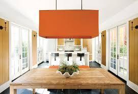 color pops of orange make a florida house oh so chic
