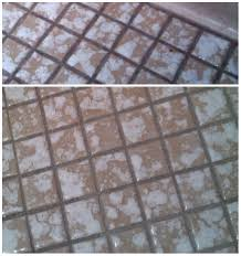 cleaning grout on small bathroom tile floor with oxiclean
