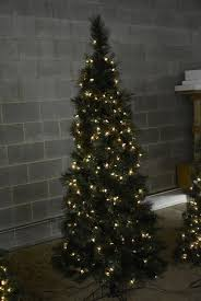 Artificial Christmas Tree 65 Foot Tall Filled With 300 White Lights