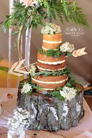 Three Tier Naked Wedding Cake With Elder Flowers And Foliage