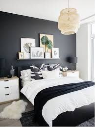 Example Of A Trendy Light Wood Floor And Beige Bedroom Design In Toronto With Black