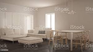 moderne saubere wohnzimmer mit schiebetür und esstisch sofa sessel und chaiselongue minimale weiße und graue innenausstattung stockfoto und mehr