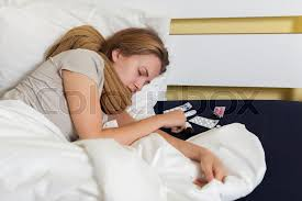 teen caught a cold sick and lying in bed stock photo