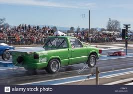 A Green Small Pickup Truck Gets The Green Light At The Drag Races In ... Truck Drag Racing In Canada Involves Rolling Coal And 71 Tons Of Semi Trent Willson Radical Classic Chevy San Antonio Paramount Trucks Unbelievable Race Of Two 9second 2003 Dodge Ram Cummins Diesel Big Tire Gmc Customized S10 Body Style For Bkk Thailandjune 24 Isuzu Stock Photo Edit Now Amazing With Fully Loaded Trailers Fords Version The Farm Fordtrucks