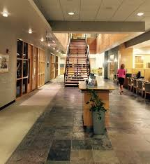 Modern Sustainable Business Office Spaces Include Natural Atrium Lighting Open Staircases Materials For Flooring And Walls Lots Of Plants