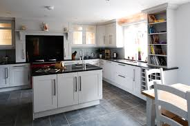 interior tile laminate floors in kitchen with white wooden wall