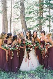 Bridal Party Standing In The Forest