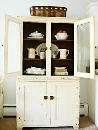 Old Fashioned White Antique Kitchen Hutch Featuring Bottom Crown Molding With Metal Plate Knob Door Cabinets And Upper Glass Front 3 Graded Shelves