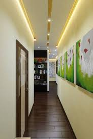 bright hallway colour ideas with led lighting and wall gallery