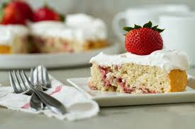 Growing up our summers were full of strawberry shortcake My mom would slice up tons of ripe berries sprinkle them with sugar and let them macerate in the