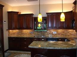 cherry cabinet kitchen and really like back splash combo with